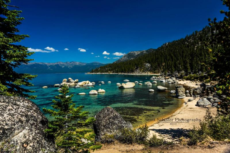 SECLUDED BEACHES ARE AVAILABLE AT LAKE TAHOE A SHORT HIKE FROM THE HIGHWAY
