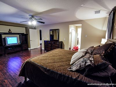 MASTER BEDROOM WITH ATTACHED MASTER BATH AND BALCONY