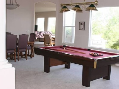 THE DALMATIAN HOME HAS DINING FOR UP TO TEN AND A GAME ROOM WITH GREAT VIEWS